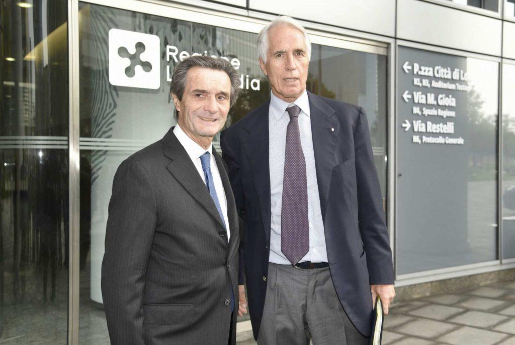 Il presidente della Regione Lombardia Attilio Fontana , a  sinistra, con il Presidente del CONI Giovanni Malago'